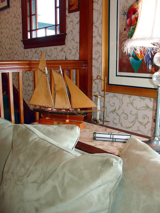 more casual and comfortable sitting room by the porch overlooking the harbor...great place to enjoy early morning coffee